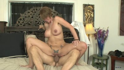 Horny MILF with big tits..