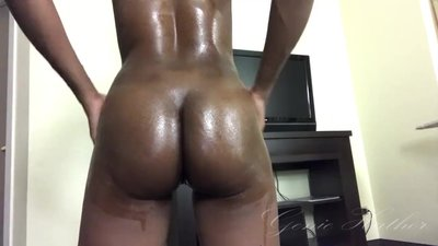 Naked ebony oiled up and..